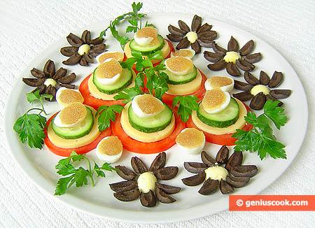 Antipasto con caviale di luccio e uova di quaglia