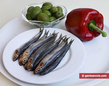 Ingredienti per le alici marinate con olive farcite